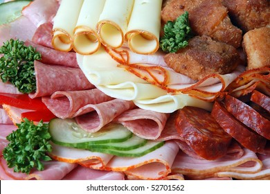 Salami and cheese rolls with vegetables