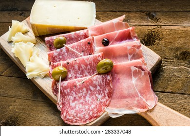Salami, ham and cheese platter with olives.