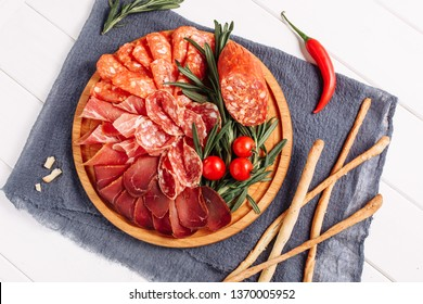 Salami Meat Board Platter Dried Slice Flat Lay. Breadsticks, Ham, Prosciutto and Chorizo Spain Starter Snack Appetizer Top Down View. Charcuterie Dried Delicatessen Traditional Spanish Party Overhead