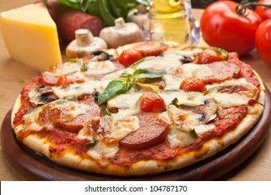 salami, mushroom and vegetable pizza with ingredients