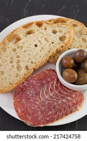 salami with olives and bread