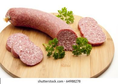 Salami onto wood plates