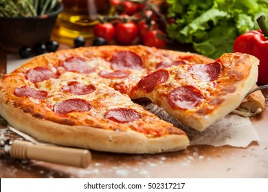 Salami pizza lifted 1 slice