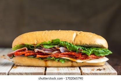 Salami sandwich on baguette with linen backdrop