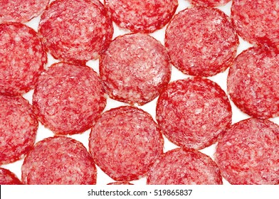 Salami sausage slices isolated on white background.