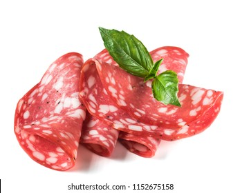 Salami sliced. Raw smoked sausage slices isolated on white background. Few pieces or several slices. Side view of four slice of raw smocked sausage with basil leaf isolated on white with clipping path