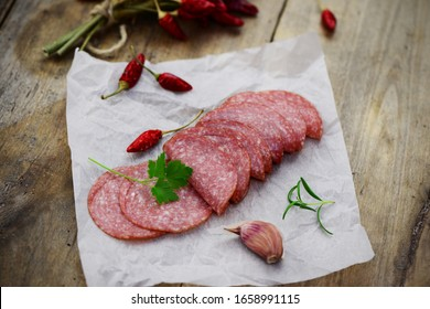 Salami slices with hot peppers