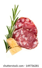 salami slices, parmesan cheese and rosemary isolated on white