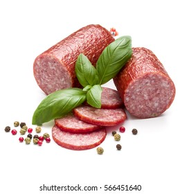Salami smoked sausage, basil leaves and peppercorns isolated on white background cutout.