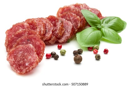 Salami smoked sausage slices, basil leaves and peppercorns isolated on white background cutout