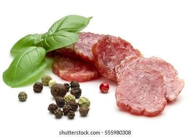 Salami smoked sausage slices, basil leaves and peppercorns isolated on white background cutout.
