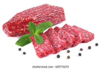 Salami smoked sausage with slices and mint leaves isolated on white background cutout
