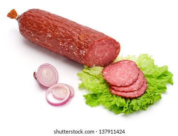 Salami stick and slices with vegetables