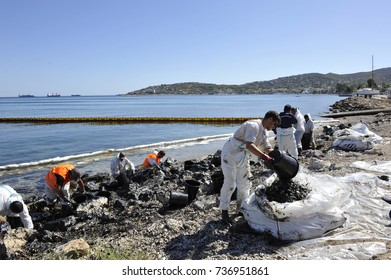 Salamis Island. Piraeus - Athens. Greece. 13 September 2017. Workers remove oil trying to clean beaches in Saronic Gulf  near Athens Greece. The oil leaked from the wreck of the tanker Agia Zoni 2.