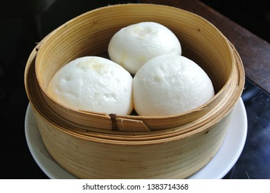 Salapao in bamboo steamer, Steamed stuff bun or Chinese Steamed Buns.