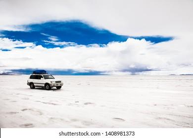 Salar de Uyuni, Bolivia - Dec, 31, 2018: Off-road car driving through Salar de Uyuni salt flat in Bolivia