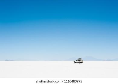Salar de Uyuni, Bolivia - March, 26, 2017: Off-road car driving on Salar de Uyuni salt flat in Altiplano, Bolivia.