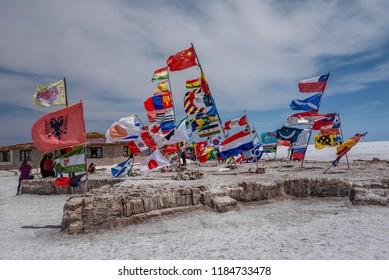 Salar de Uyuni, Bolivia- March 25, 2017: Flags of various nations at Salar de Uyuni ( Salt Lake), Bolivia