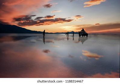 Salar de Uyuni, Bolivia- March 25, 2017: Tourist enjoy the Sunset at lake Salar de Uyuni in Bolivia