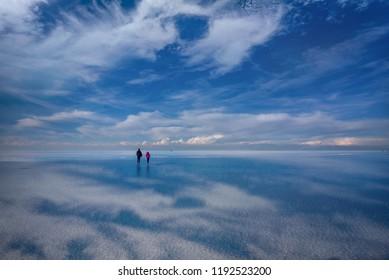 Salar de Uyuni, Bolivia- March 25, 2017: People walking on the lake Salar de Uyuni, Bolivia