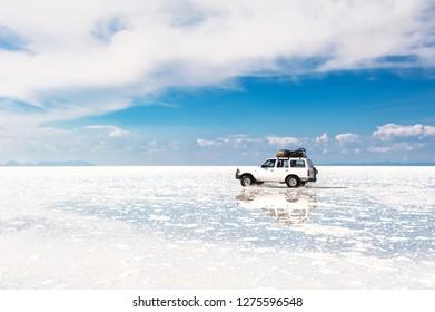 Salar de Uyuni, Bolivia - March, 26, 2017: Off-road car driving through Salar de Uyuni salt flat in Bolivia