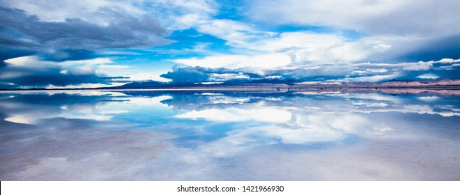 The Salar de Uyuni flooded after the rains, Bolivia. Clouds reflected in the water of the Salar de Uyuni, Bolivia