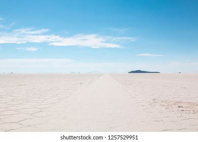 Salar de Uyuni, Salt flat in Bolivia.  Blue Sky and white salt ground. Uyuni, Bolivia