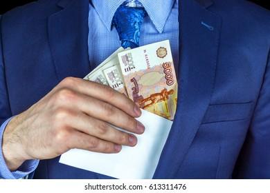 Salaried employee in an envelope. Focus on money.