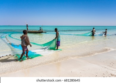 SALARY, MADAGASCAR, JUL 22: Six fishermen and their fishing net in the Salary lagoon, southwestern Madagascar on july 22, 2016.