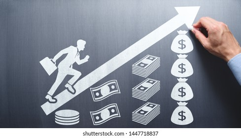 Salary and savings increase concept. Drawing money and businessman going up hill on chalkboard.