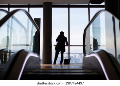 salaryman silhouette by the glass wall