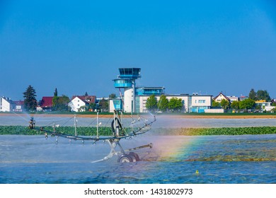 salat field and artificial watering with airport tower at the airport Stuttgart