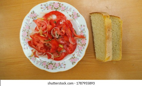 Salat from tomato,onion and basil leaves