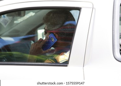 SALAVDOR, BAHIA / BRAZIL - October 21, 2016: Driver is seen using the mobile device while driving in the city of Salvador (BA).