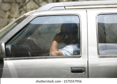 SALAVDOR, BAHIA / BRAZIL - September 3, 2012: Driver is seen using the mobile device while driving in the city of Salvador (BA). *