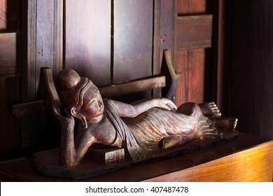 "Salay,Myanmar-May 12,2010 : Wooden sleeping buddha , spectacular woodcarvings art at the famous monastery ""Yoke-Sone-Kyaung'' ."