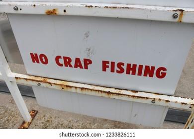 Salcombe. Devon. England. April 30, 2011.No crap fishing sign. South west coast path.
