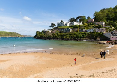 SALCOMBE, DEVON, ENGLAND-MAY  31ST  2015: Sunny summer weekend  weather drew visitors to the seaside at South Sands, Salcombe, Devon on Sunday 31st May 2015