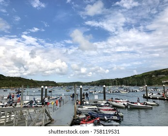 Salcombe, West Hams, Devon, United Kingdom. 31st August 2017. Salcombe harbour Devon, UK with ferry terminal on a jetty and small leisure craft moored on the water  With unidentified people.