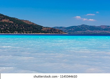 Salda Lake is a mid-size crater lake in Burdur. Salda Golu in Turkey. Blue lake background.
