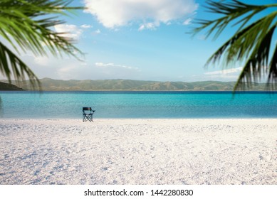 Salda lake which is like Maldives with white sand and turquoise colored water with an empty chair and palm leaves on the scene. Burdur / Turkey.