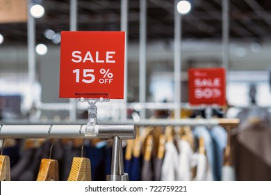 sale 15% off mock up advertise display frame setting over the clothes line in the shopping department store for shopping, business fashion and advertisement concept