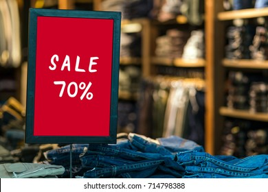 sale 70 off mock up advertise display frame setting over the bucket jeans in the shopping department store for shopping, business fashion and advertisement concept