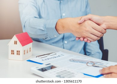 Sale agent and customer handshake and sign agreement contract, Insurance Home concept