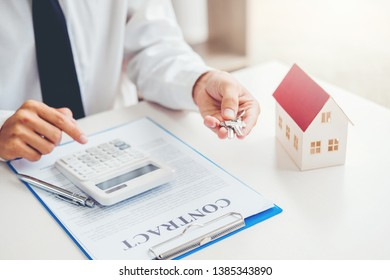 Sale agent giving Key house to customer and sign agreement contract, Insurance Home concept