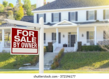 For Sale By Owner Real Estate Sign and Beautiful House.