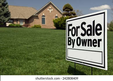For Sale By Owner Sign In Front Of Nice Home