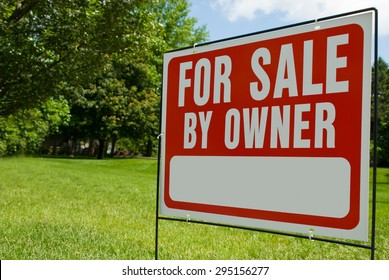 For Sale By Owner Sign. Picture of a For Sale By Owner sign in a yard. Has copy space for adding text.