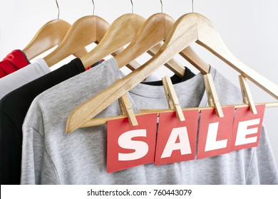 Sale in a clothing store - discount sign at a clothes rack
