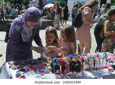 Sale of designer jewelry during the Kiyv East Fest festival dedicated to the Islamic holiday Ramazan Bayram in Taras Shevchenko Park, in Kiev, June 5, 2019